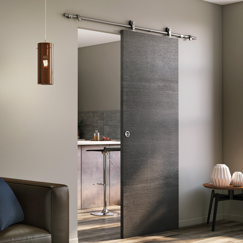 une porte coulissante en bois sur rail inox pour séparer
